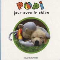 Popi joue avec le chien
